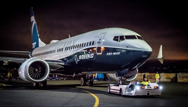 Boeing 737 MAX on the tarmac being tugged.