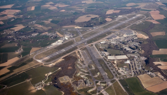 An aerial view of Cornwall's Newquay Airport showing runways, taxiways and surrounding fields