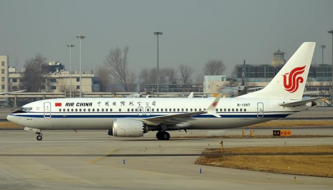 An Air China Boeing 737 Max aircraft taxiing on the ground at an airport