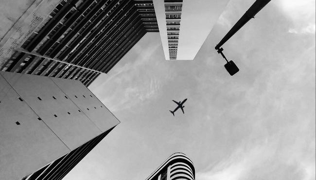 Aeroplane flying over city