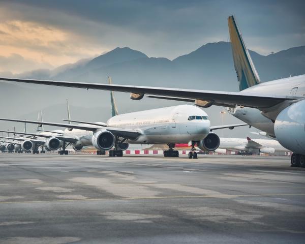 Fleet of aircraft parked on a runway