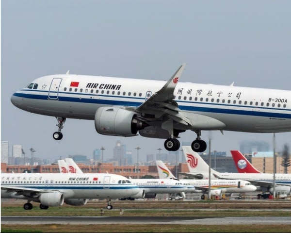 Air China aircraft taking off into the sky on the runway
