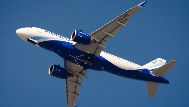 An Airbus A320 NEO aircraft in flight, operated by IndiGo airlines.